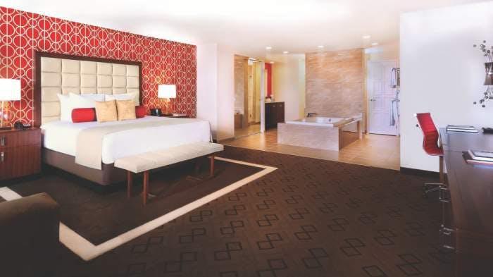 https://suiteness.imgix.net/destinations/las-vegas/bally-s-las-vegas/suites/jubilee-grand-suite-1-king/bedroom.jpg?w=96px&h=64px&crop=edges&auto=compress,format