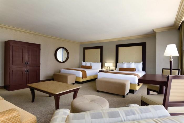 https://suiteness.imgix.net/destinations/las-vegas/rio-all-suite-hotel-casino/suites/deluxe-masquarade-tower-2-queens-smoking-deluxe-masquarade-tower-2-queens-smoking/bedroom.jpg?w=96px&h=64px&crop=edges&auto=compress,format