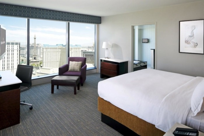 https://suiteness.imgix.net/destinations/las-vegas/elara-by-hilton-grand-vacations/suites/corner-2-bedroom-2-king-suite-with-sofabed/bf3ac450_z-jpg.jpg?w=96px&h=64px&crop=edges&auto=compress,format