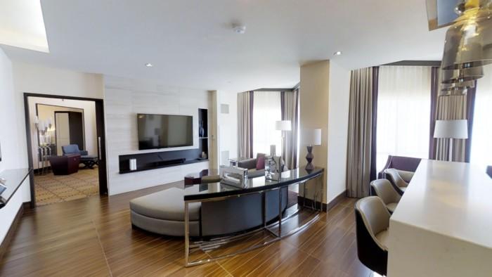 https://suiteness.imgix.net/destinations/las-vegas/harrah-s-hotel-and-casino-las-vegas/suites/valley-tower-vice-presidential-suite-1-king-2-queens/living-room.jpg?w=96px&h=64px&crop=edges&auto=compress,format