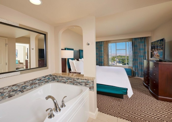 https://suiteness.imgix.net/destinations/las-vegas/hilton-grand-vacations-on-paradise-convention-center-/suites/2-bedroom-1-king-2-queens-suite-with-sofabed/bedroom.jpg?w=96px&h=64px&crop=edges&auto=compress,format