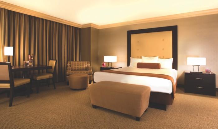https://suiteness.imgix.net/destinations/las-vegas/rio-all-suite-hotel-casino/suites/deluxe-masquerade-tower-1-king-non-smoking-deluxe-masquerade-tower-2-queens-non-smoking/bedroom.jpg?w=96px&h=64px&crop=edges&auto=compress,format