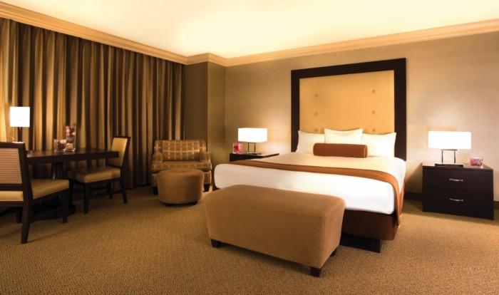 https://suiteness.imgix.net/destinations/las-vegas/rio-all-suite-hotel-casino/suites/deluxe-masquerade-tower-1-king-smoking-deluxe-masquerade-tower-2-queens-smoking/bedroom.jpg?w=96px&h=64px&crop=edges&auto=compress,format